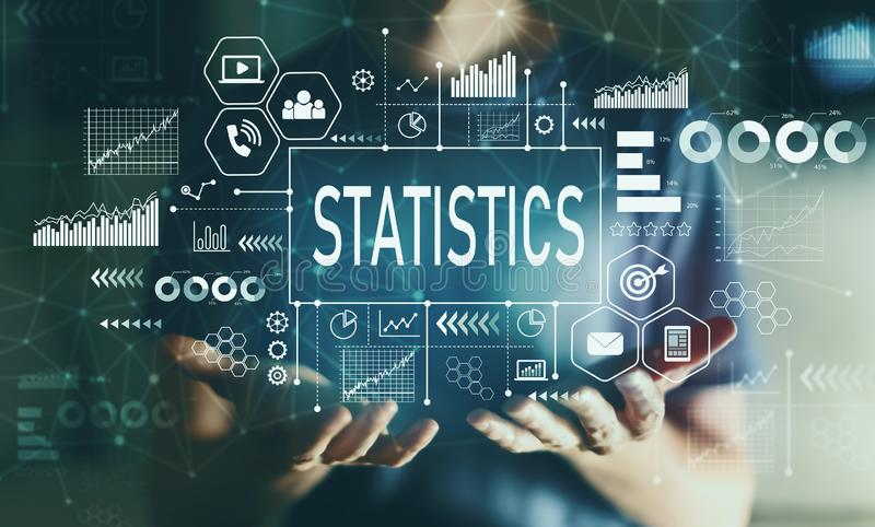 Statistics with young man. In the night royalty free stock photography
