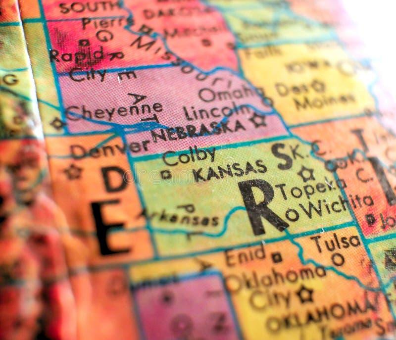 Stato colpo del fuoco di Kansas U.S.A. di macro sulla mappa del globo per i blog di viaggio, i media sociali, le insegne di web e fotografie stock