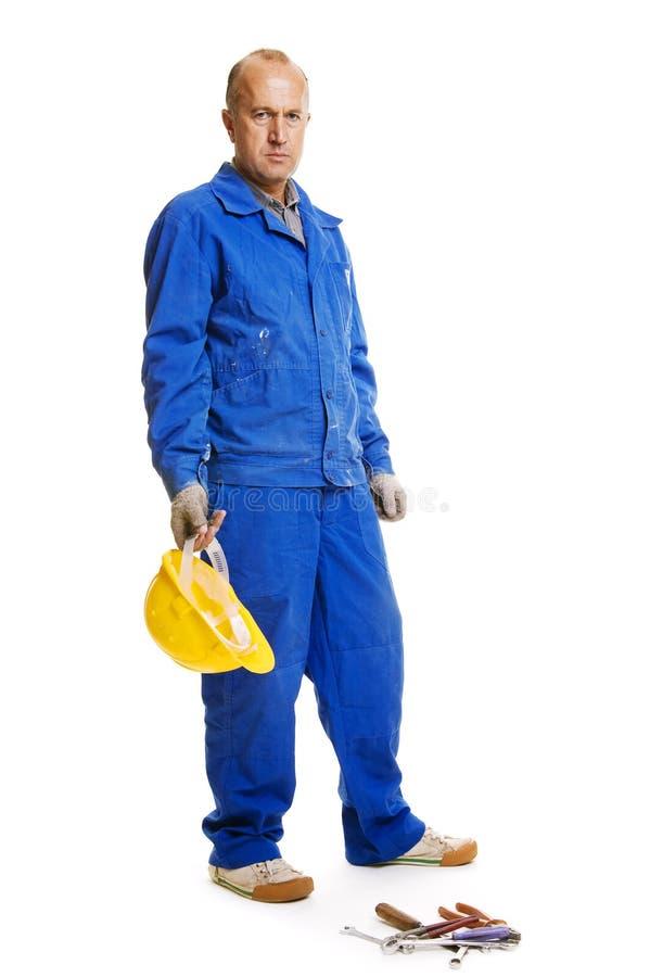 Stattliche ernste Arbeitskraft stockfoto