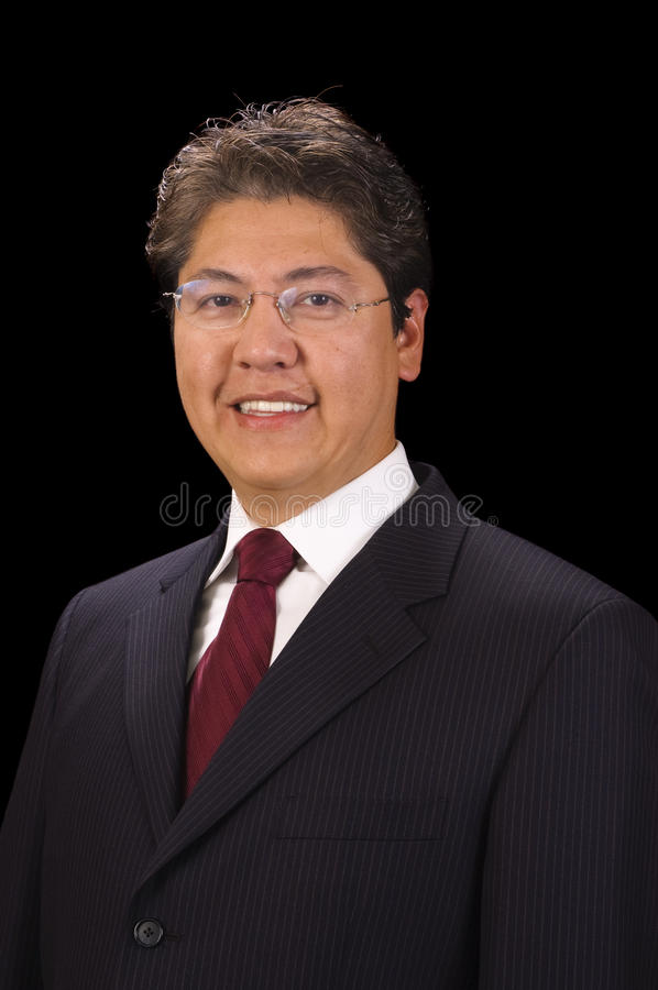 Stattlicher asiatischer Geschäftsmann lizenzfreie stockfotografie