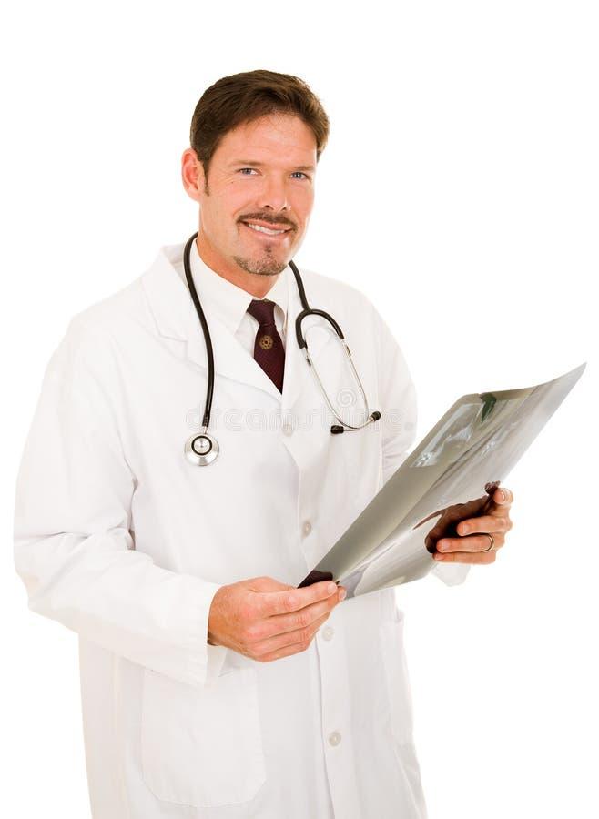Stattlicher Doktor mit Röntgenstrahl lizenzfreie stockbilder