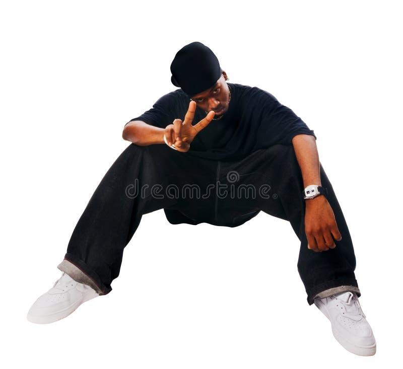 Stattlicher Hip-hopjunger Mann auf Weiß stockbild