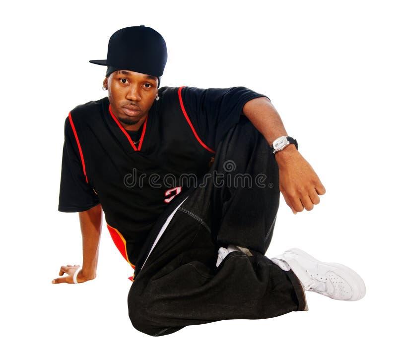 Stattlicher Hip-hopjunger Mann auf Weiß stockfotografie