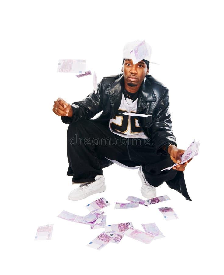 Stattlicher Hip-hopjunger Mann mit Bargeld auf Weiß lizenzfreies stockfoto