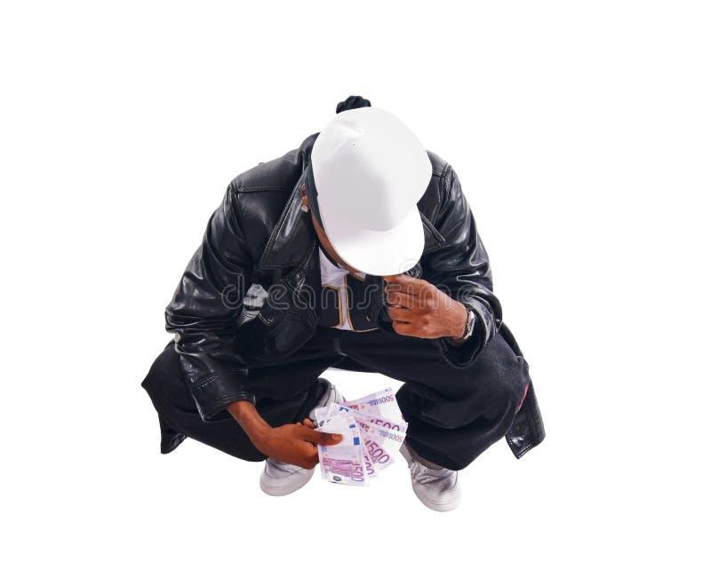 Stattlicher Hip-hopjunger Mann mit Bargeld auf Weiß lizenzfreie stockfotografie