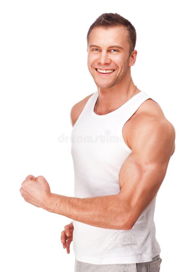 Stattlicher junger muskulöser Sportmann stockbilder