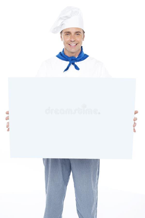 Stattlicher männlicher Chefholding-Anzeigenvorstand lizenzfreie stockbilder