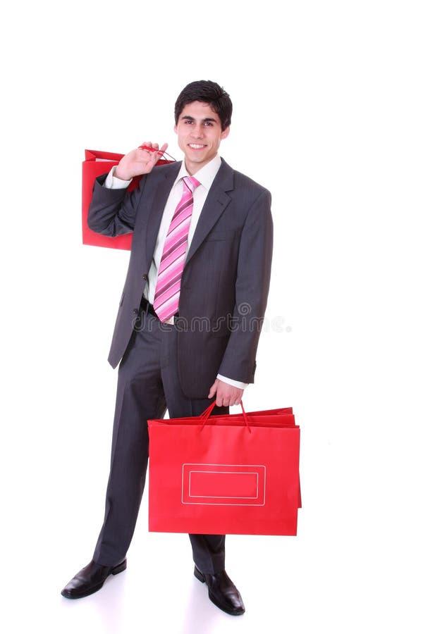 Stattlicher Mann mit Einkaufenbeuteln lizenzfreie stockfotos