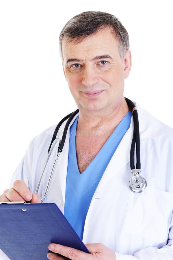 Stattliches fälliges männliches Doktorschreiben lizenzfreie stockfotografie