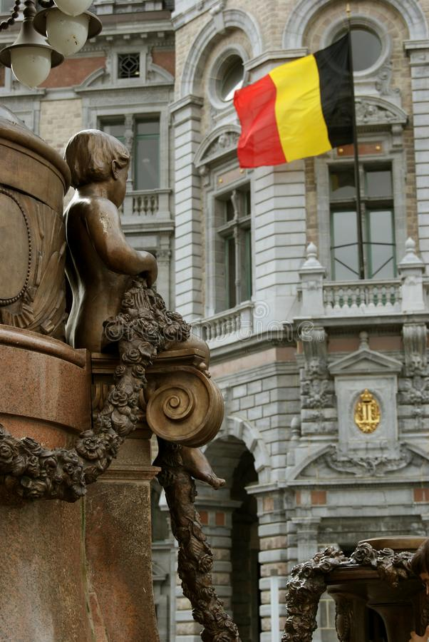 Download Statue Of Young Boy Looking At Belgian Flag Royalty Free Stock Photo - Image: 30530245
