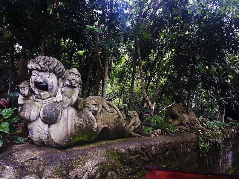 Statua all'entrata interna alla foresta della scimmia, Ubud, Bali, Indonesia immagini stock libere da diritti