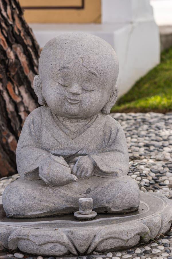 Statua alla sua Lai Buddhist Temple, California del monaco dell'allievo fotografia stock libera da diritti