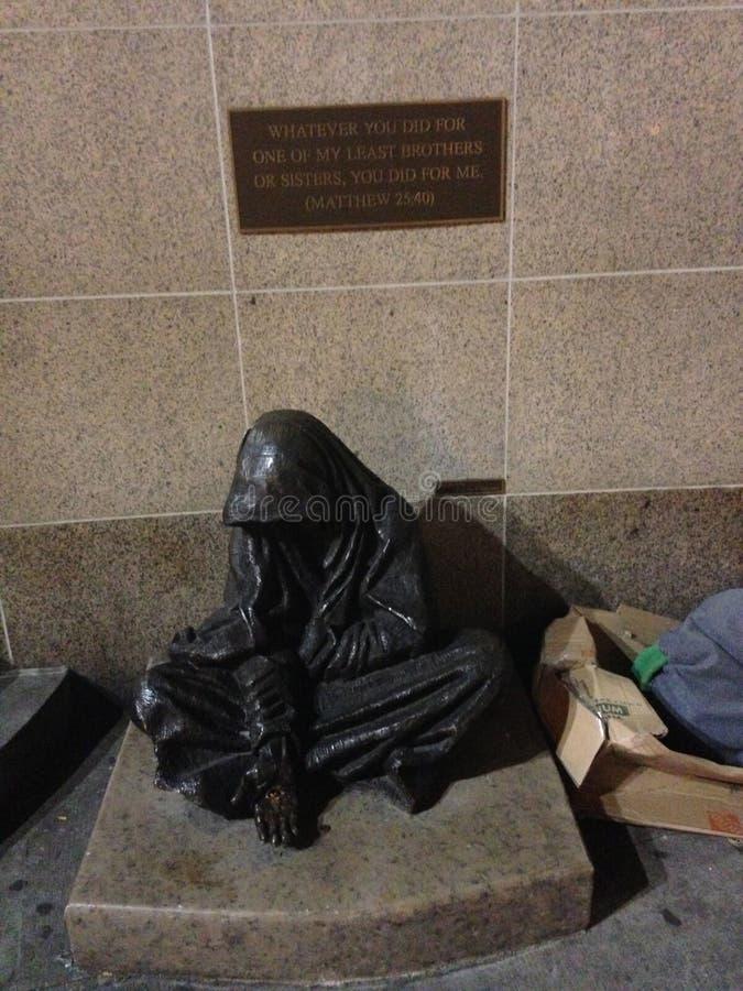 Statua bezdomny żebrak zdjęcia stock