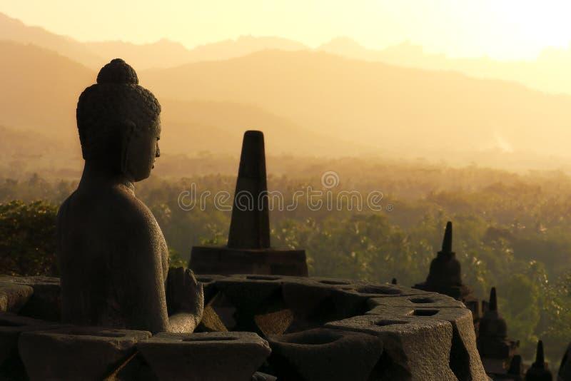 Statua in Borobudur, Java, Indonesia del Buddha immagini stock