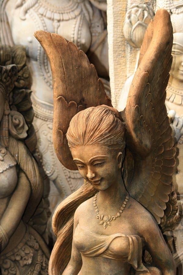 Statua buddista di pietra di angelo, Tailandia. fotografia stock libera da diritti