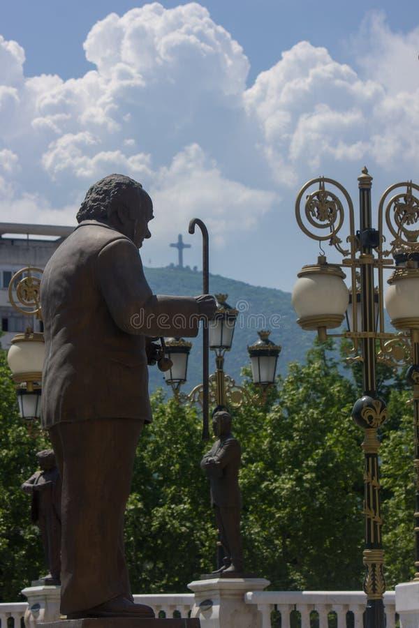 Statua con la canna a Skopje, Macedonia fotografia stock libera da diritti