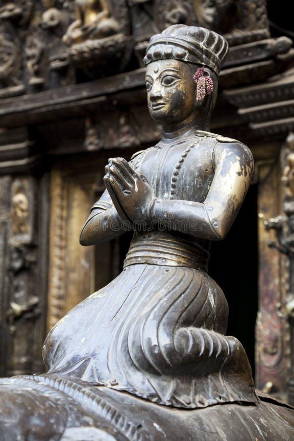 Statua d'ottone al tempiale dorato, Patan, Nepal fotografie stock