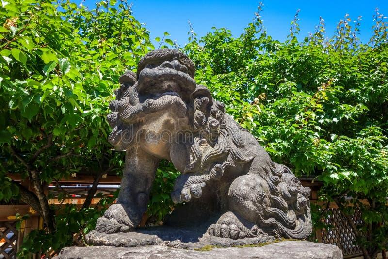 Statua del cane del leone di Komainu, Tokyo, Giappone immagine stock libera da diritti