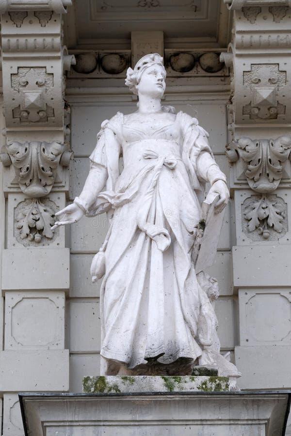 Statua del commercio, rappresentazione allegorica, dettaglio di municipio, Graz fotografia stock