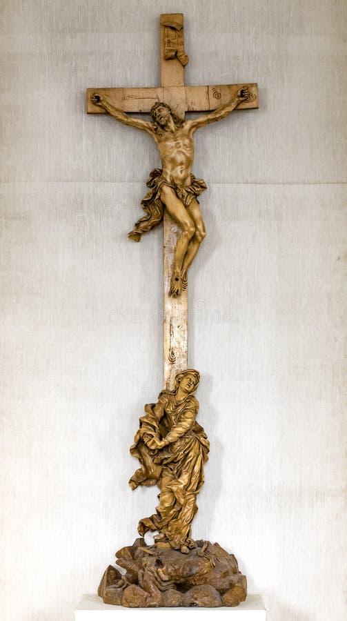 Statua di Jesus Christ su un incrocio fotografie stock