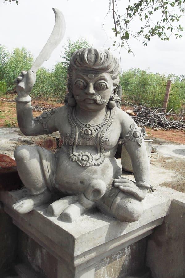 Statua di Karupanasamy in tempio munishwarar a vediyarendal fotografia stock
