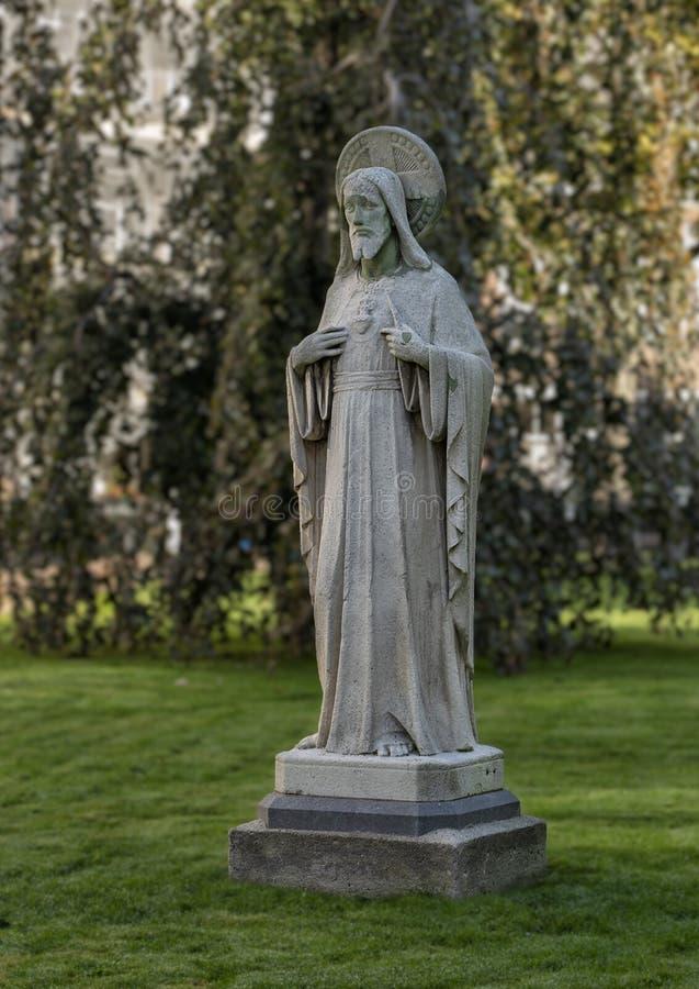 Statua di pietra di cuore sacro di Jesus Christ, Amsterdam Begijnhof immagini stock libere da diritti