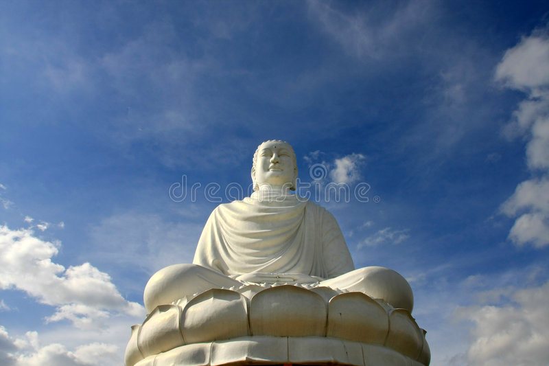 Statua di seduta del buddha immagini stock