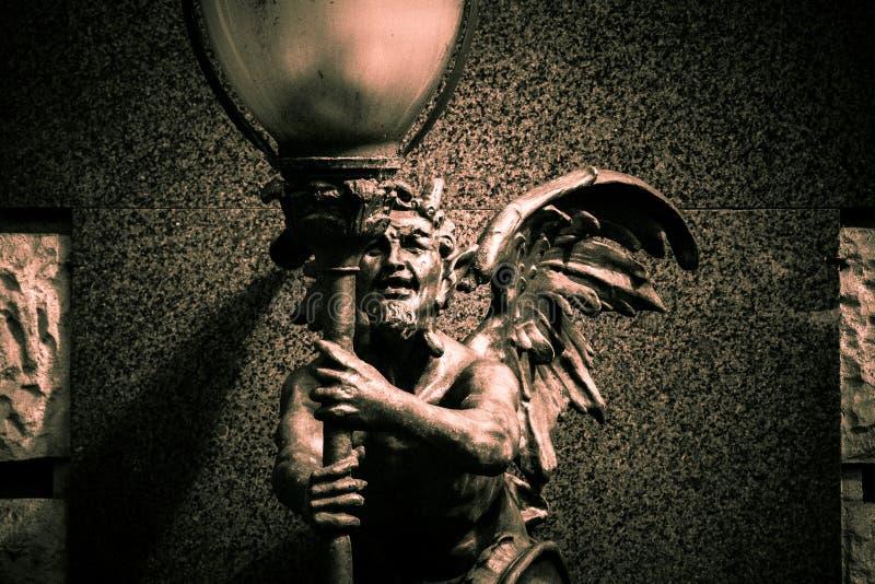 Statua di un demone fotografia stock libera da diritti