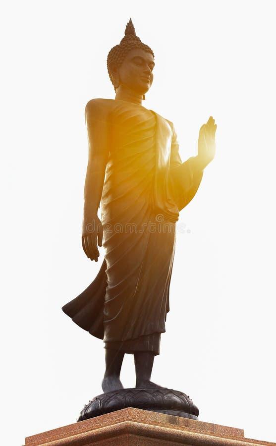 Statua e luce solare di Buddha fotografia stock