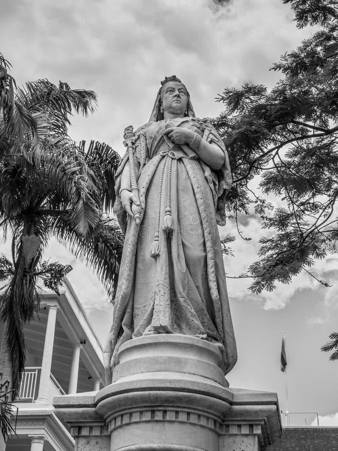 Statua królowa Wiktoria, rzędu dom, Francuski Kolonialny buil obraz stock