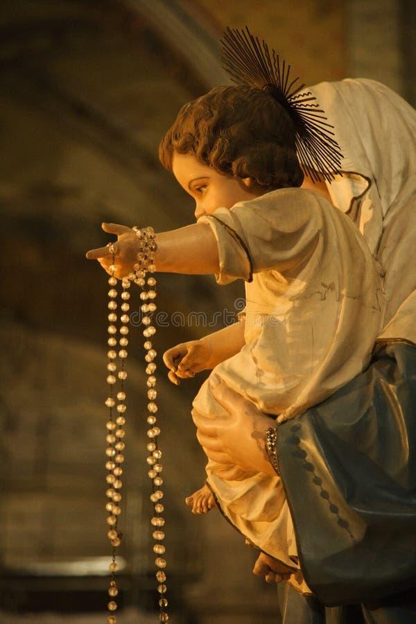 Statua religiosa a Roma, Italia. fotografia stock libera da diritti