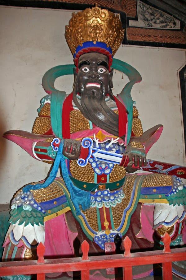 Statua variopinta di re celeste al tempio buddista cinese fotografia stock libera da diritti