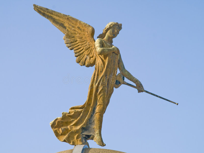 Statue. Stone statue of an angel with a trumpet in his hand royalty free stock image