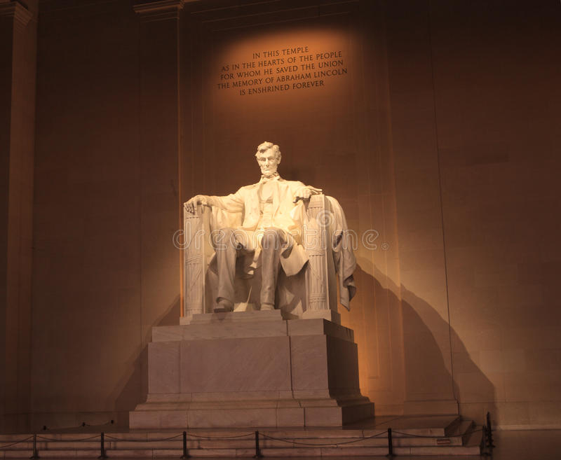 Abraham Lincoln Washington DC Monument. Illuminated night photo of statue of President Abraham Lincoln in the Lincoln Memorial in Washington, DC. This American royalty free stock photo