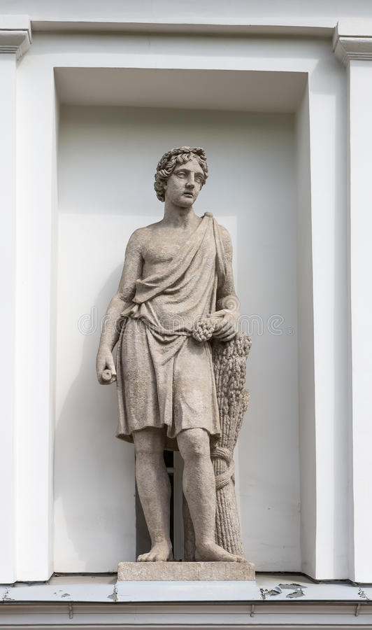 Statue of Adonis in the niche of the Kitchen Corps of the Elagin Island Palace and Park Complex in St. Petersburg royalty free stock photography
