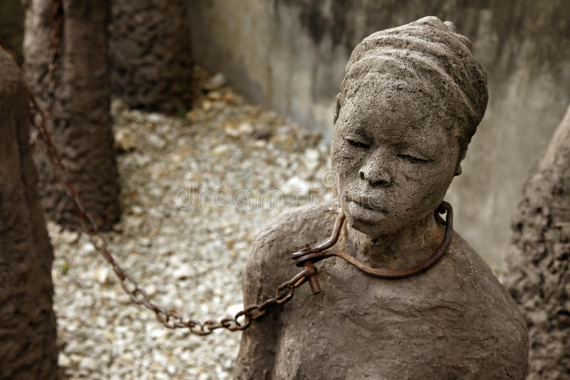 Statue africaine du commerce slave image libre de droits