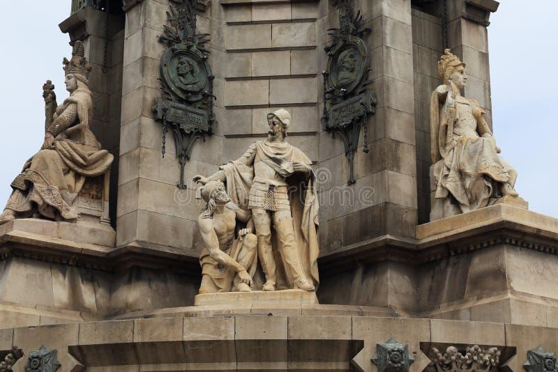 Statue al piede di Columbus Monument Column, Barcellona fotografie stock