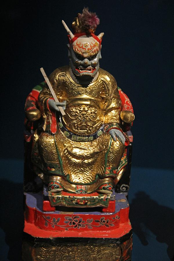 Confucian god. The statue of ancient confucian god inside the confluence museum at lyon in france stock images