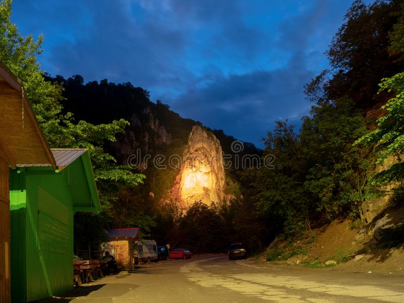 Statue of ancient king Decebal, in the Cazane gorge, lit at night royalty free stock photo