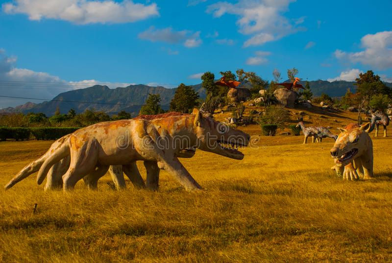 Statue of an ancient wolf in the field. Prehistoric animal models, sculptures in the valley Of the national Park in Baconao, Cuba. Statue of an ancient wolf in stock image