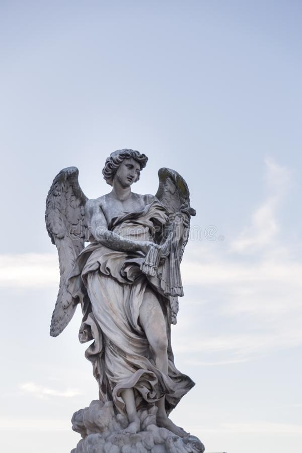 Statue of an angel against blue sky with clouds on bridge in rom stock photos
