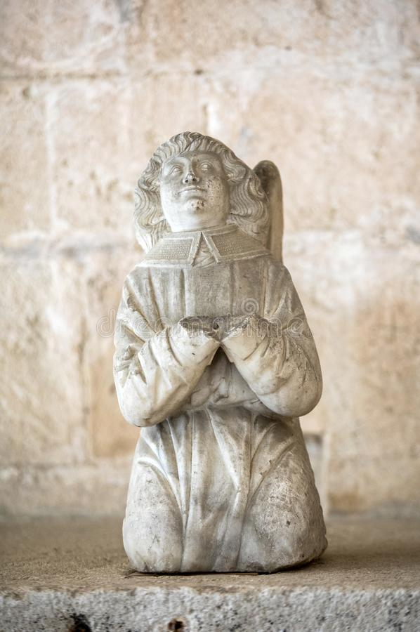 Statue of angel in the cloisters of the Abbey of Montmajour near Arles, stock photography