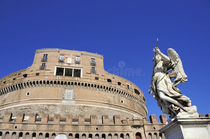 Angel`s Castle in Rome. Statue of an angel and detail of the Old fortress Angel`s Castle Rome, Italy royalty free stock image