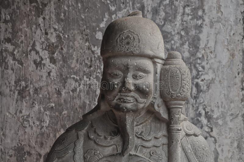 Statue antique chinoise de pierre de guerrier image stock