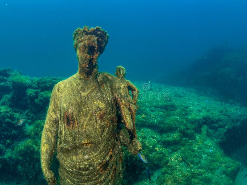 Statue of Antonia Minor in Claudio's Ninfeum. underwater, archeology. Lost wonders of Baiae, fashionable Roman resort town where numerous emperors owned royalty free stock photo