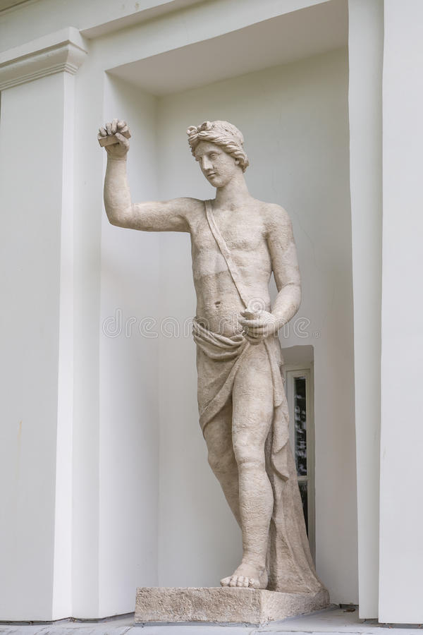Statue of Apollo in the niche of the Kitchen Corps of the Elagin Island Palace and Park Complex in St. Petersburg. The God Apollo. Statue of Pudozh stone in the royalty free stock photo