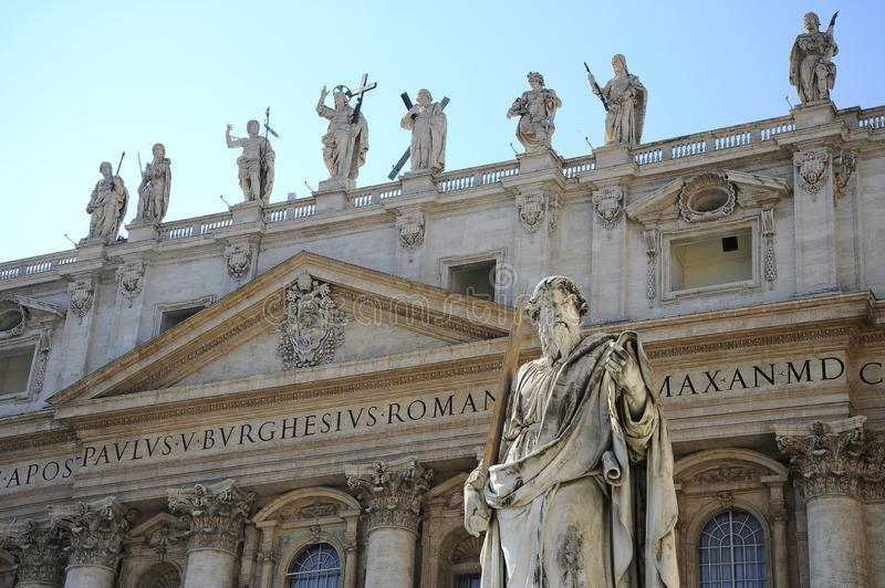 Statue of Apostle Paul in front of the St Peter`s Basilica, Vatican City Rome, Italy. stock images