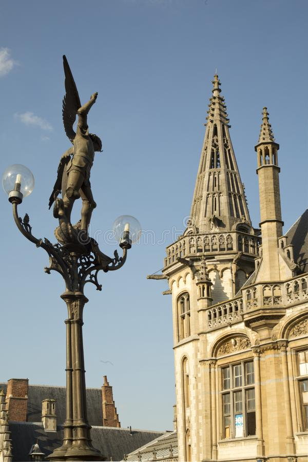 Statue of Archangel Michael on the bridge of Saint Michael in Ghent, Belgium. royalty free stock photo