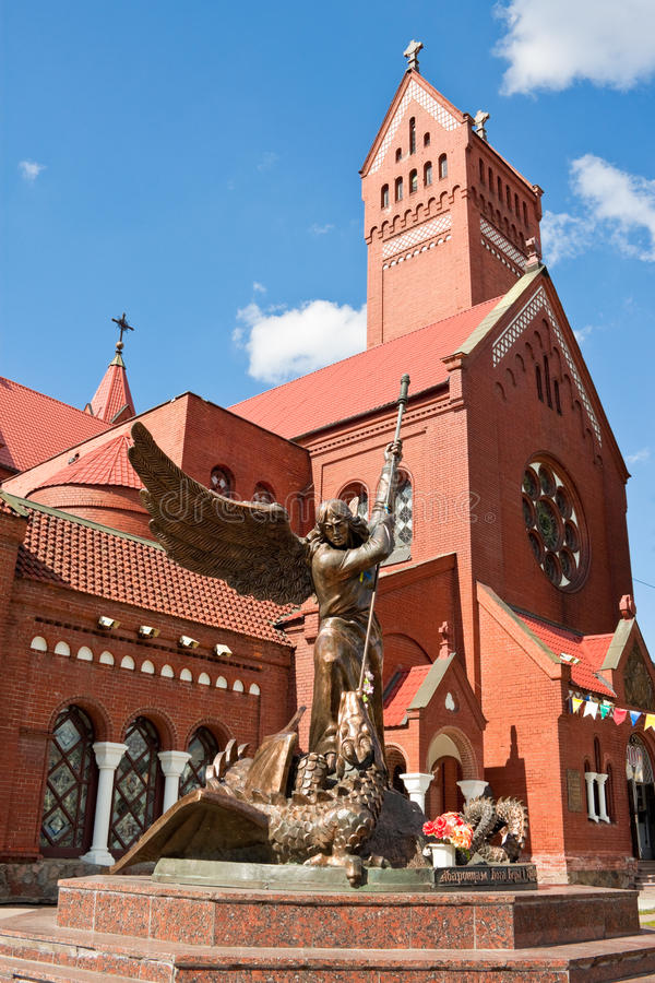 Statue of Archangel Michael and the Catholic Church of St. Simon royalty free stock image