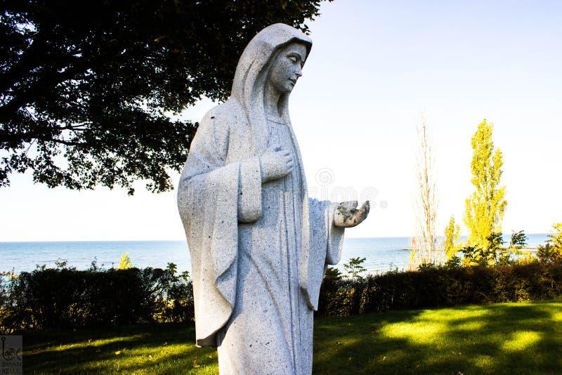 Statue au-dessus de regarder le Michigan photos stock